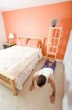 Man Doing Push-Ups in Bedroom Stock Photos