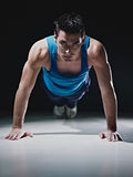 Man doing push-ups on black background Royalty Free Stock Images
