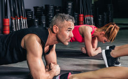 Man doing push ups in fitness class Royalty Free Stock Image
