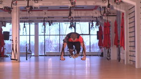 Man doing push UPS. In fitness hall stock video footage