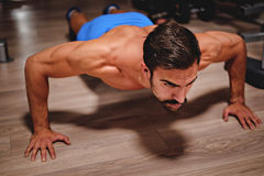 Man doing push ups. In the gym royalty free stock photos