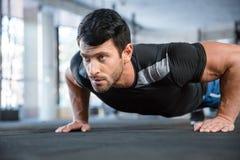 Man doing push ups in gym royalty free stock photo