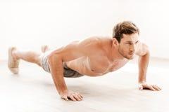 Man doing push-ups. Royalty Free Stock Images