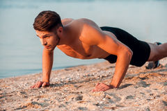 Man doing push-ups. Stock Photos