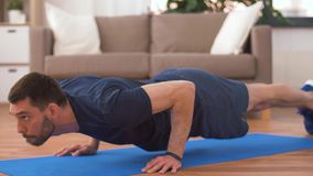 Man doing push ups at home. Fitness, sport, training and concept - man doing push ups at home stock video