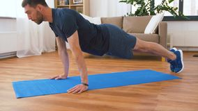 Man doing push ups at home. Fitness, sport, training and concept - man doing push ups at home stock footage