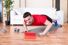 Handsome man workout with push ups at home royalty free stock image