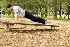 Man Doing Push-ups - horizontal Stock Image