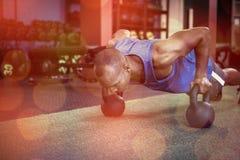 Man doing push-ups with kettlebells Royalty Free Stock Photo