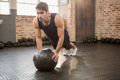 Man doing push ups on medicine ball. At the gym Royalty Free Stock Image