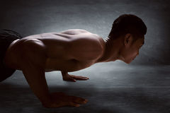Man doing push ups. Muscular man doing sport push ups Stock Images