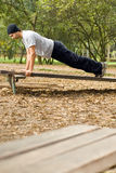 Man Doing Push-ups Outside - vertical Royalty Free Stock Photography