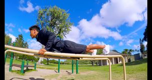 Man doing push-ups on parallel bars 4k. Man doing push-ups on parallel bars at park 4k stock video