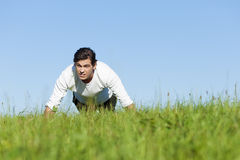 Man doing push ups in summer grass Stock Photography