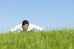 Man doing push ups in summer grass Royalty Free Stock Image