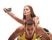 Man doing push ups and woman fun with selfie Royalty Free Stock Photography