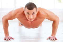 Man doing push-ups. Stock Photography