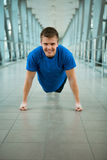 Man doing pushed exercises in the modern bridge construction Royalty Free Stock Photography