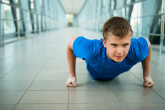 Man doing pushed exercises in the modern bridge construction Stock Photography