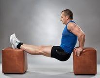 Man doing pushup dips Stock Photo
