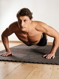 Man doing pushups Stock Images