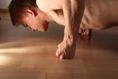 Man doing pushups Stock Images
