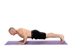 Man doing pushups. Fitness trainer doing pushups on a yoga mat Stock Image