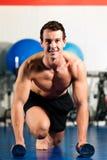 Man doing pushups in gym royalty free stock photo