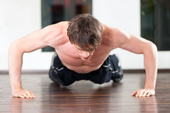Man doing pushups in gym Royalty Free Stock Photo