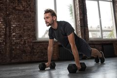 Man doing pushups at the gym Stock Photo