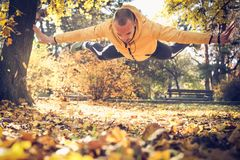 Man doing pushups with jump. On the move. Royalty Free Stock Photography
