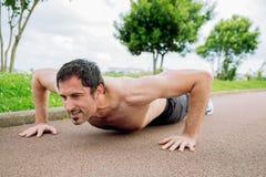 Man doing pushups outdoors. Mid adult man doing pushups outdoors shirtless Stock Photos
