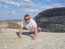Man doing pushups outdoors in nature. Royalty Free Stock Photos
