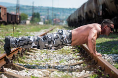 Man Doing Pushups On Railroad Stock Images