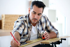 Man doing renovation work at home Royalty Free Stock Image