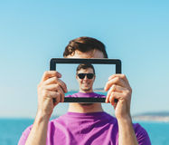 Man doing a self-portrait with him digital tablet Royalty Free Stock Photo