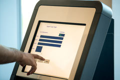 Man doing self-registration for flight, close up Royalty Free Stock Images