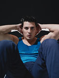 Man doing series of sit-ups on black background Royalty Free Stock Photography