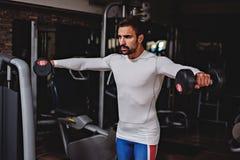 Man doing shoulder lateral raises Royalty Free Stock Image