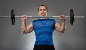 Man doing shoulder workout with barbell Royalty Free Stock Photos