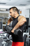 Man doing shoulder workout in a gym Royalty Free Stock Image
