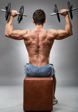 Man doing shoulder workout in studio Royalty Free Stock Image