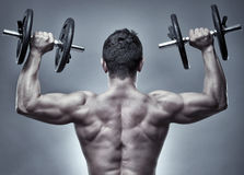 Man doing shoulder workout in studio Stock Photography