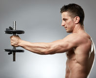 Man doing shoulder workout in studio Royalty Free Stock Photos