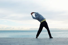 Man doing side bends Stock Images