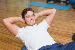 Man doing sit up on exercise ball Royalty Free Stock Photo