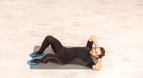Man Doing Sit-ups Stock Photo