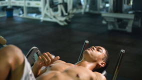 Man doing sit ups fitness exercise at sport gym stock footage