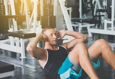Man doing situp or crunches in gym,Men exercise muscular his stomach in door stock photos
