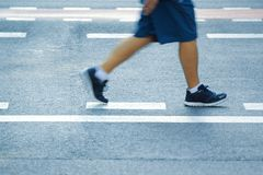 Man doing some jogging in the street. Urban sport. Stock Photos
